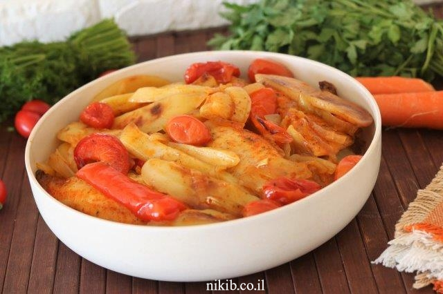 פילה אמנון על מצע ירקות ועשבי תיבול